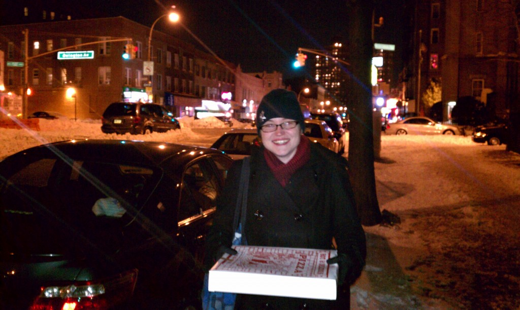 I'd rather be holding this box of pizza than stuck in that stranded minivan!